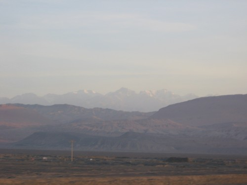 A bit smoggy that day (as when wasn't it), but if you squint you can see the Tian Shan, or Heavenly Mountains on the horizon.